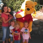 Getting a picture with Pooh. Kallen still not impressed