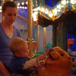 Kallen on a carousel. He is curious to know whats in the sea lions mouth.