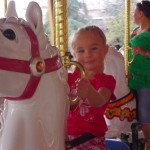 Braylee on a carousel. She liked those
