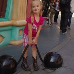 Braylee trying to lift some toon bar bells.
